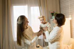 Grandmother mum and granddaughter. In the room, happy family with the baby royalty free stock photos