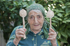 Grandmother with mushrooms Stock Images
