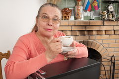 The grandmother and the new computer. Stock Images
