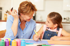 Grandmother Painting With Granddaughter At Home Royalty Free Stock Photography