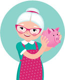 Grandmother a pensioner in an apron shakes a piggy bank Stock Photography