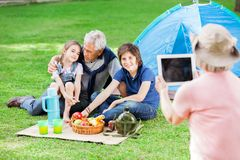 Grandmother Photographing Family At Campsite Royalty Free Stock Image