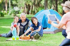 Grandmother Photographing Family At Campsite Royalty Free Stock Photo