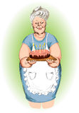 Grandmother with a pie Royalty Free Stock Images