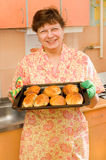The grandmother with pies Stock Images