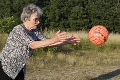 Grandmother by play with the ball Stock Photo