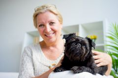 Grandmother with a dog Royalty Free Stock Photo