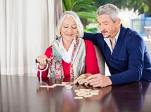 Grandmother Playing Dominoes With Grandson stock photo