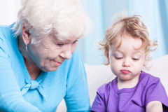 Grandmother playing with grandson Royalty Free Stock Photo