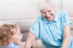 Grandmother playing with grandson Stock Photo
