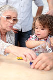 Grandmother playing with grandson Royalty Free Stock Photography