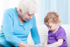 Grandmother playing with grandson Stock Photography