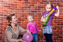 Grandmother playing with her grandchildren Royalty Free Stock Image