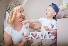 Grandmother playing with her grandson, a lot of interesting details. Royalty Free Stock Photography