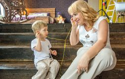 Grandmother playing with her grandson, a lot of interesting details. Royalty Free Stock Image