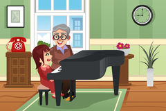 Grandmother Playing Piano with her Granddaughter Stock Photos