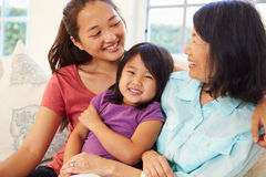 Grandmother Playing On Sofa With Granddaughter And Daughter Royalty Free Stock Photo