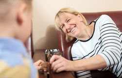 Grandmother playing with young boy Royalty Free Stock Image