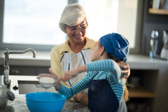 Grandmother praising granddaughter. And smiling in the kitchen Stock Photos