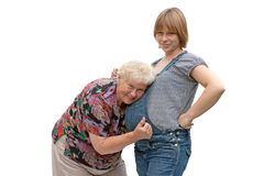 Grandmother with pregnant granddaughter Stock Image
