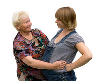 Grandmother with pregnant granddaughter Stock Photos