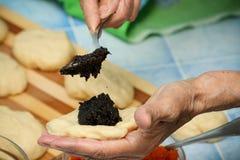 Grandmother prepares pies Stock Images
