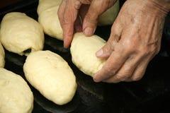 Grandmother prepares pies Royalty Free Stock Photos
