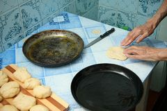 The grandmother prepares pies Stock Photography