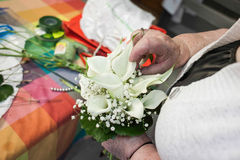 Grandmother Preparing a bouquet of flowers Stock Images