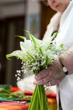 Grandmother Preparing a bouquet of flowers Royalty Free Stock Photography