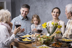 Grandmother proposing a toast with family Royalty Free Stock Photos