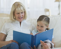 Grandmother reading Stock Image