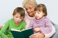 Grandmother reading a book Stock Photography