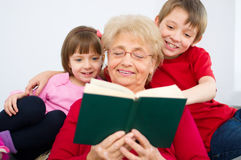 Grandmother reading Stock Photos