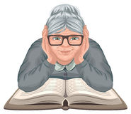 Grandmother reading book. Old woman in glasses placed his hands on an open book Stock Photos