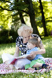 Grandmother reading the book to her grandson Royalty Free Stock Images