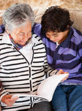 Grandmother reading a story Stock Photos