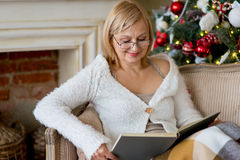 Grandmother relaxing on a sofa in front of the family Christmas Royalty Free Stock Photo