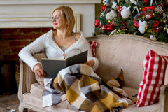 Grandmother relaxing on a sofa in front of the family Christmas Stock Photography
