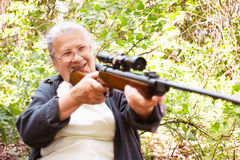 Grandmother with rifle Stock Photos