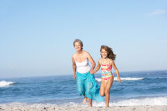 Grandmother Running With Granddaughter Royalty Free Stock Image