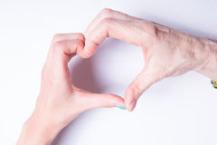 Grandmother's and children's hands form heart Stock Images