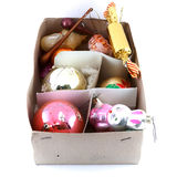 Grandmother's old Christmas tree decorations. In a cardboard box Stock Photos