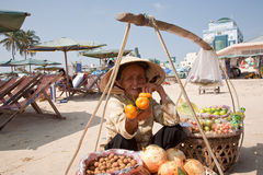 Grandmother - a saleswoman fruit Royalty Free Stock Photography