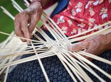 Working weave bamboo Asia Lifestyle countryside. Grandmother senior asian woman working weave bamboo Asia Lifestyle countryside Royalty Free Stock Image
