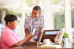 Grandmother Showing Document To Grandson Royalty Free Stock Photos