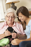 Grandmother Showing Granddaughter How To Crochet At Home Royalty Free Stock Image