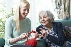 Grandmother Showing Granddaughter How To Knit Stock Photos