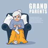 Grandmother sitting in armchair and knitting socks Royalty Free Stock Image