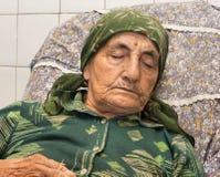 Grandmother sleeping Stock Images
